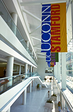 Banners hang in the atrium of the Stamford Campus.